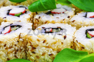 Sushi rolls with lettuce leaves