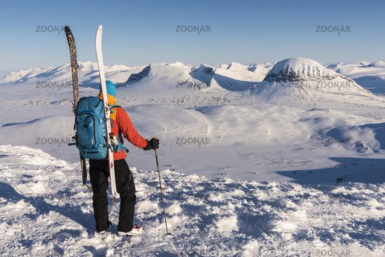skier watching mountains in Sarek NP, world heritage Laponia, Lapland, Sweden