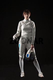 The portrait of woman wearing white fencing costume  on black