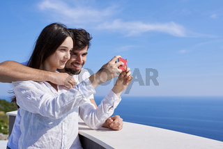 young couple taking selfie with phone
