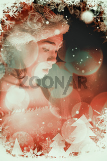 Composite image of amazed brunette in santa outfit opening a gift
