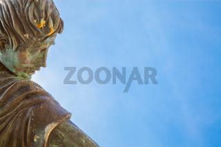Bronze head and sky
