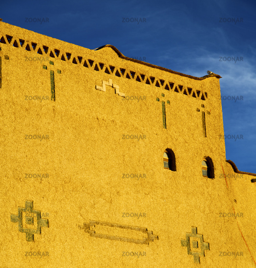 old brown construction in africa morocco and sky  near the tower