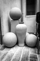 Unfinished ceramic pot and sphere shapes in pottery workshop