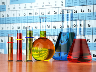 Science chemistry concept. Laboratory test tubes and flasks with colored liquids on the periodic table of elements.