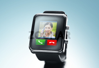 close up of black smart watch with video call icon
