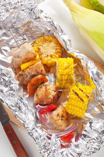 Shish kebab and grilled corn