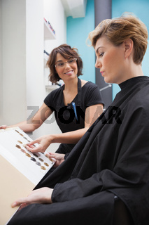 Hairdresser showing hair colour types
