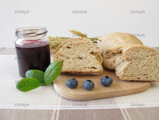 Twisted bread and blueberry jam