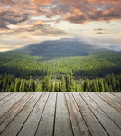 Wooden deck overlooking scenic view of mountains