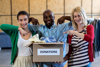 Colleagues holding donation box