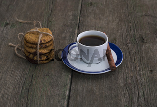 cup of coffee and linking of oatmeal cookies
