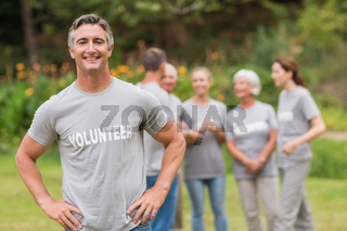 Smiling volunteer looking at camera