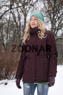 blond woman in snowy forest