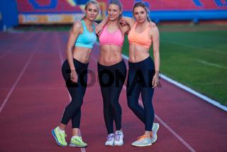 athlete woman group  running on athletics race track
