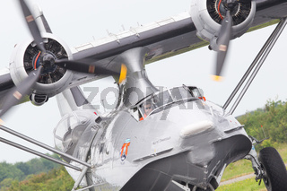 LEEUWARDEN, NETHERLANDS - JUNE 11: Consolidated PBY Catalina in Dutch Navy colors flying at the Royal Netherlands Air Force Days June 11, 2016 in Leeuwarden, Netherlands.