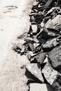 pile of asphalt pieces on roadside