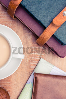 Close-up of coffee with wallet and diaries