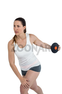 Female athlete playing discus throw on white background