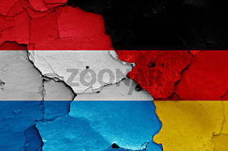 flags of Luxembourg and Germany painted on cracked wall