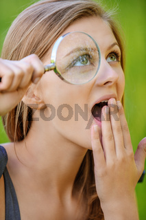 portrait of young woman with loupe
