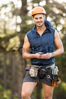 Handsome young hiker looking at camera