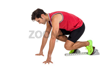 Male athlete in ready to run position