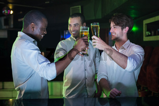 Group of men toasting with glass of beer