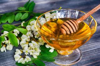 Acacia honey on wooden background