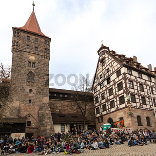 People gathering and sitting at Tiergartner Tor Platz in nuremberg