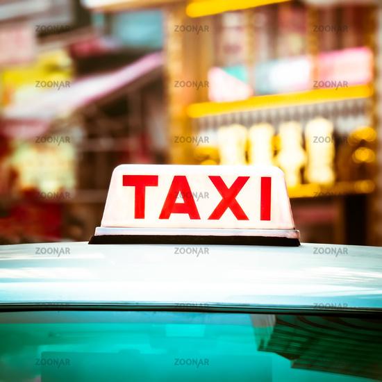 Taxi car at night city. Hong Kong