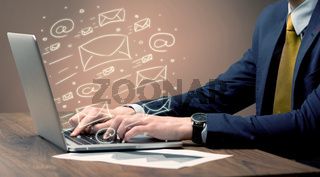 Sending client news letters on laptop