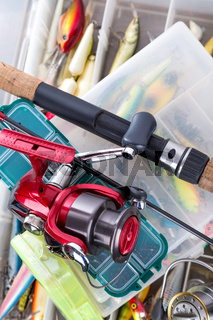 fishing tackles on boxes with different lures
