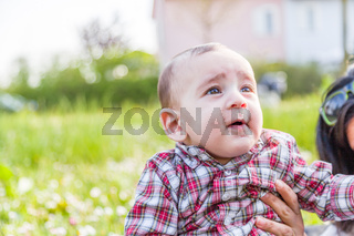 Funny face of cute 6 months baby