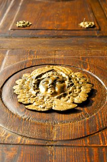 gold face  house  door     in italy  lombardy           closed  nail rusty