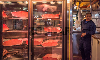 TOKYO, JAPAN - November, 22, 2014: Tuna sellers at Tsukiji, the biggest fish and seafood market in the world.