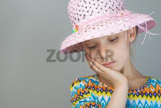 Little girl reflects