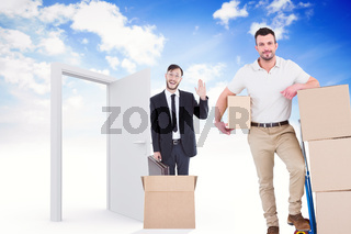 Composite image of delivery man with trolley of boxes