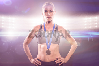 Composite image of athlete posing with gold medal around his neck