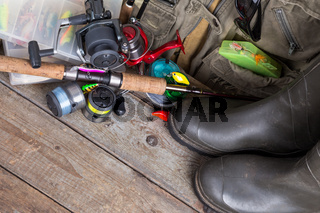 fishing tackles with fishing vest and boots