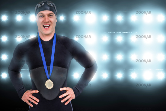 Composite image of victorious swimmer posing with gold medal around his neck