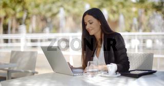 Pretty stylish woman using her laptop