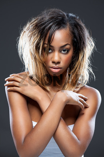 Portrait of an young black beauty with perfect skin