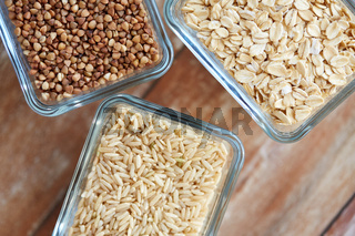 close up of grain in glass bowls on wooden table