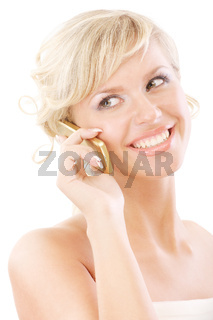 Beautiful blonde speaks by telephone and smiles