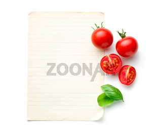 chopped tomatoes and basil leaf with blank paper