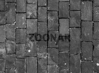 Dark paving stone roadway