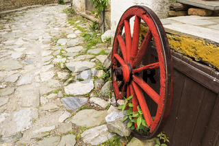 Old Wooden Red Wagon Wheel
