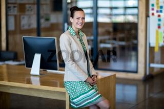 Businesswoman sitting on her desk
