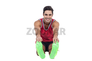Portrait of male athlete doing stretching exercise